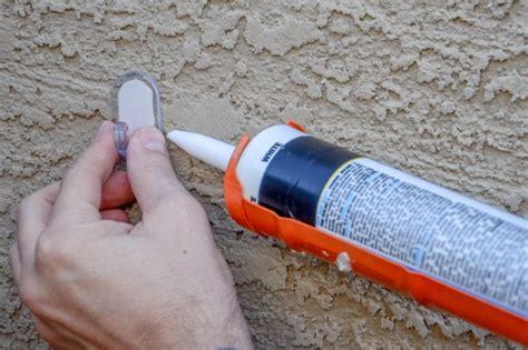 stapler for christmas lights how to hang lights on stucco hunker