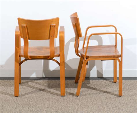 an pair of bent plywood arm chairs by thonet at