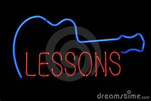 Guitar Lessons Neon Sign Royalty Free Stock Image