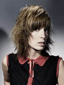 Wearable layered hairstyle with thick curved bangs and pointed strands  Medium
