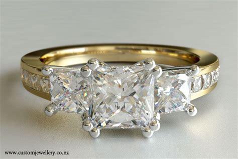 3 stone princess cut diamond engagement ring yellow gold