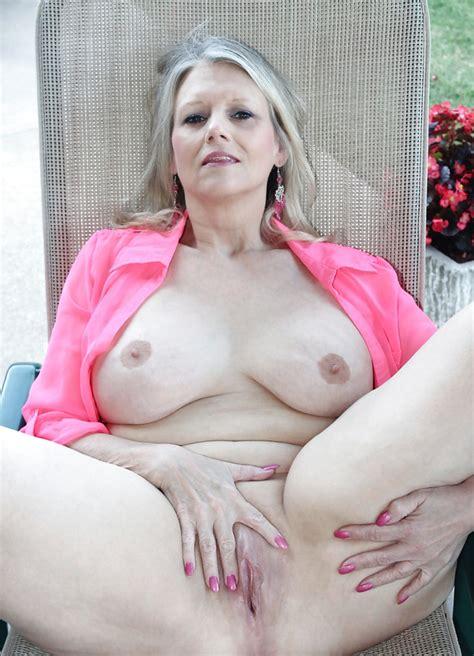 Mature Woman Nude In Her Garden