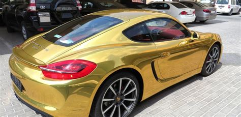 gold porsche truck porsche cayman wrapped chrome gold