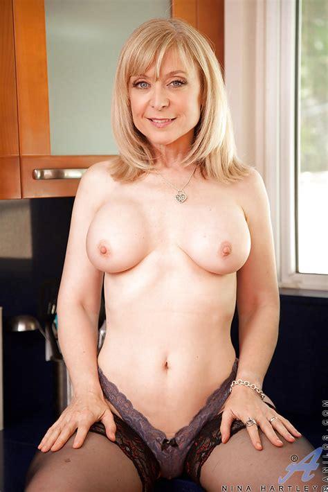 blonde mature nina hartley teases her big tits while masturbating