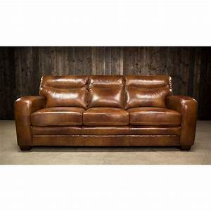 Elements international montebello leather sofa with low for Sectional sofas royal furniture