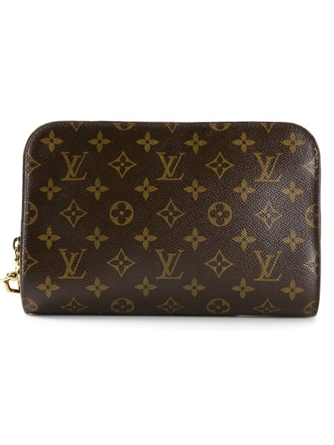 louis vuitton monogram orsay clutch  brown lyst