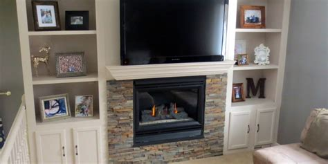 barn door tv wall remodelaholic fireplace makeover with built in shelves