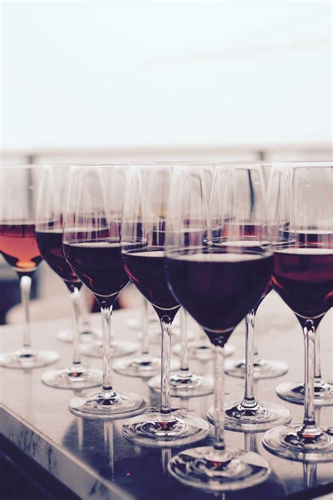 wine glass  red liquid  black table  stock photo