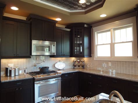 Dark Cabinets, Light Granite Countertops And Grey Vertical