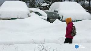 Snowstorm wallops Boston with 20 more inches; records fall