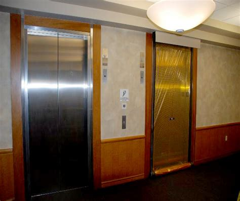 elevator smoke containment interior tech seattle