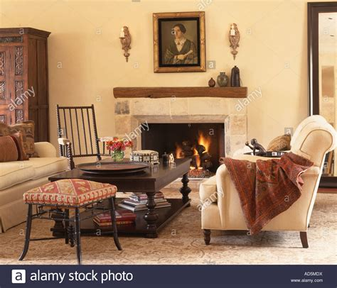 Cream Sofas With Throws And Wooden Coffee Table In Front