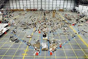 Space Shuttle Debris Lies At Kennedy Space Center