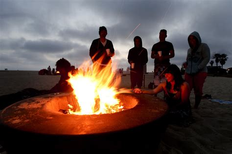 Popular Seaside Fire Pits Touch Off Dispute Over Air