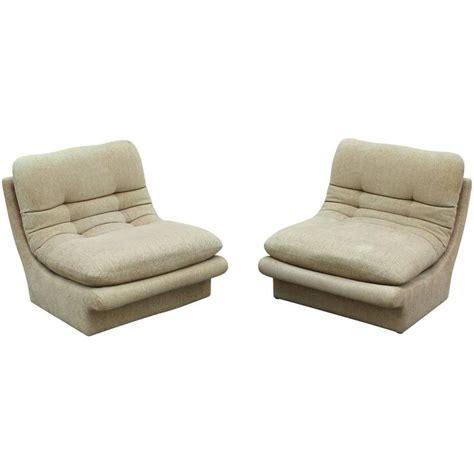 pair of vladimir kagan slipper lounge chairs and ottoman