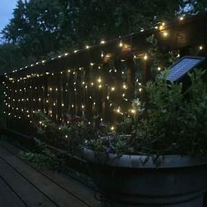 LED Solar Lights on fence makes a garden looks oh so