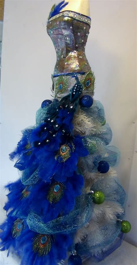 mannequin christmas tree   peacock theme seams