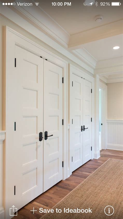 bedroom white closet doors  dark exposed hinges