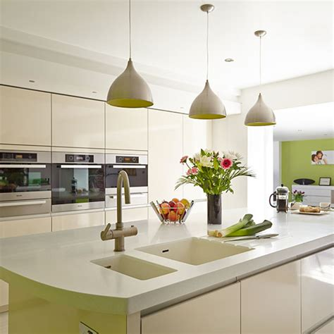white kitchen lighting modern white kitchen with island and pendant lights 1045