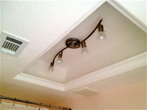 How To Change Light Fixture In Bathroom by Diy Update Fluorescent Lighting