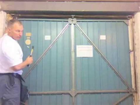 putting up a garage door how to change the cones cables wires on a henderson merlin up garage door