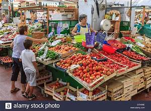 Market stall with fruit and vegetables in the market hall ...
