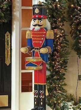 front porch  festive nutcrackers  enjoy