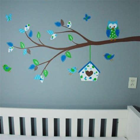 tak voor de babykamer van een jongetje met vogelhuisje
