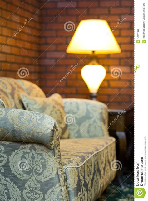 old sofa in a living room with red brick wall decor stock image image of living couch 30067949
