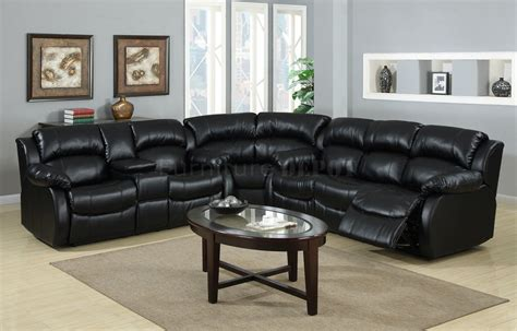 large bold black leather sectional recliner sofa and oval