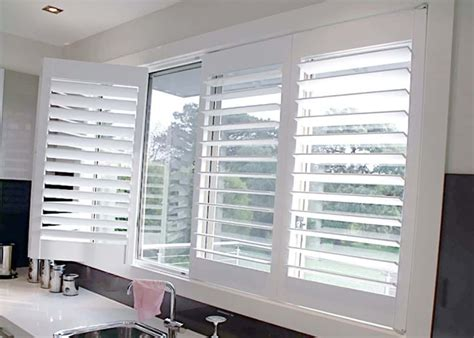 Window Shutter by Kitchen With White Countertops And White Window Shutters