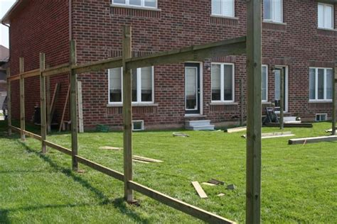 how to build a fence building a wood fence frame work where to install stringers nail size jig