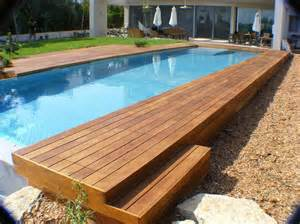 swimming pool rectangular above ground infinity pool with wooden deck and umbrella canopy also