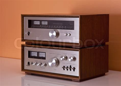vintage hi fi stereo lifier and tuner in wooden cabinets perspective stock photo colourbox