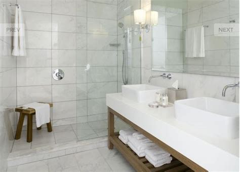marble bathroom designs large subways in white marble adorn this handsome traditional