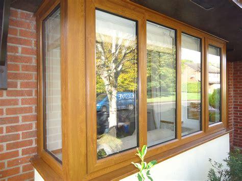 golden oak casement windows installed  cove windows  windows  white