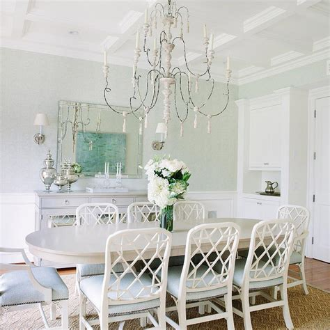 white and gray dining room with gray mirrored buffet