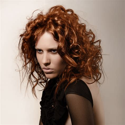 hairstyle  wild copper colored curls  messy styling