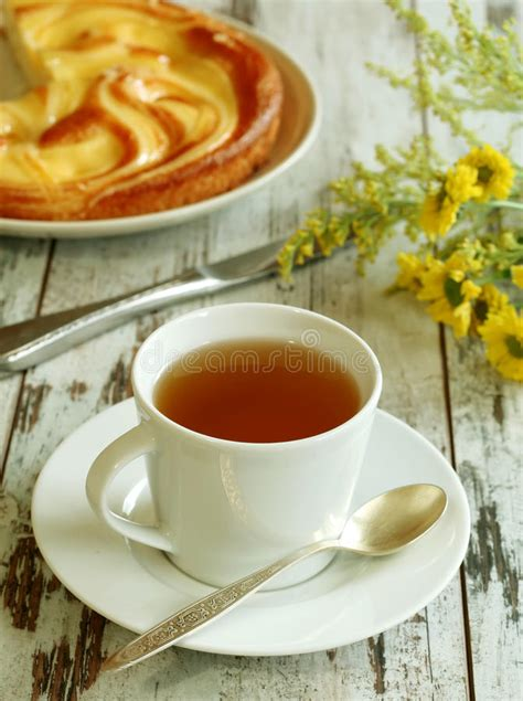 yellow spring flowers  cup  tea   wood stock