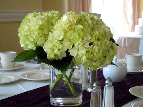centerpieces with hydrangeas dodge the florist wedding flowers katie and andy s purple and green ceremony and reception