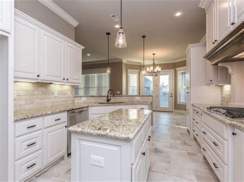 spacious white kitchen  light travertine backsplash