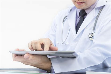 Doctor Tablett by Doctor Is Working With Tablet White Background Photo