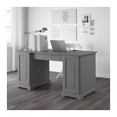 ikea liatorp desk melbourne a living room with two grey ikea hemnes bookcases filled