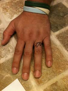 33 attractive finger tattoos for men With mens wedding ring tattoos