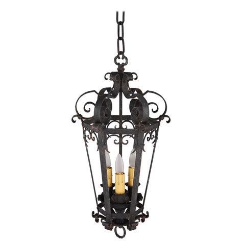 1920s wrought iron pendant with three lights for sale at