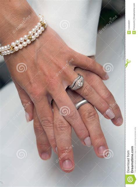 wedding rings holding stock 14444031