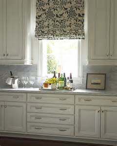 Ivory Kitchen Cabinets With Marble Countertop And