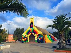 Okuda san miguel wraps a moroccan church in a vibrant for Okuda san miguel wraps a moroccan church in a vibrant geometric mural
