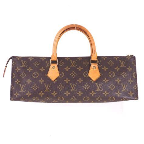 vintage louis vuitton  sac tricot triangle monogram lv hand bag nina furfur vintage boutique