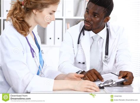 happy african american male doctor  medical staff